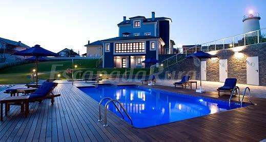 Apartamentos granda de isla casa rural en el franco for Apartamento rural con piscina privada